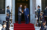 Pictured: Turkey president Recep Tayyip Erdogan is greeted by Prime Minister Alexis Tsipras outside the Maximos Mansion<br /> Re: Turkey's president Recep Tayyip Erdogan has begun a landmark visit to Greece. Thursday 07 December 2017