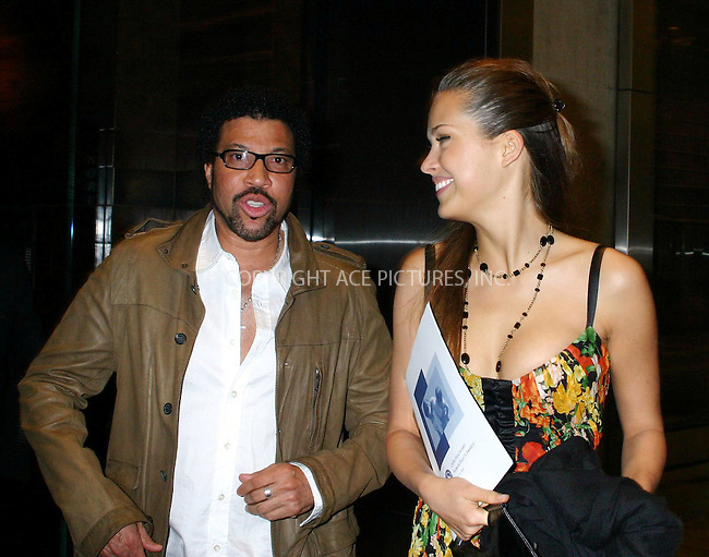 lionel richie and petra nemcova step out on the town in nyc.  bocklet