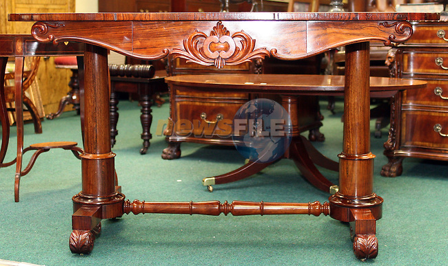 Lot 169, Victorian Rosewood Library Table, Greenes Antique Dealers...Photo NEWSFILE/Jenny Matthews.(Photo credit should read Jenny Matthews/NEWSFILE)....This Picture has been sent you under the condtions enclosed by:.Newsfile Ltd..The Studio,.Millmount Abbey,.Drogheda,.Co Meath..Ireland..Tel: +353(0)41-9871240.Fax: +353(0)41-9871260.GSM: +353(0)86-2500958.email: pictures@newsfile.ie.www.newsfile.ie.FTP: 193.120.102.198.