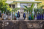 Bottles In Front Of House