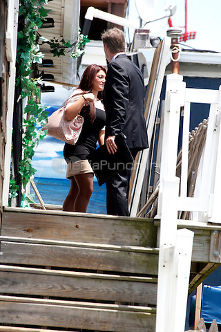 Deena Nicole Cortese pictured returning to the Shore House with her lawyer, Michael Pappa, after pleading guilty to dancing in a roadway and interfering with the flow of traffic during filming of the Jersey Shore Show in Seaside Heights, New Jersey on July 3, 2012  Deena was fined $108.00 and $33.00 court costs  © Star Shooter / MediaPunchInc