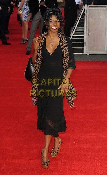 Sinitta Renet Malone.'Titanic 3D' world premiere, Royal Albert Hall, London, England..27th March 2012.full length black top dress brown leopard print.CAP/CAN.©Can Nguyen/Capital Pictures.