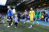 Tom Lees of Sheffield Wednesday (L) and Matt Grimes of Swansea City lead team mates onto the pitch during the Sky Bet Championship match between Sheffield Wednesday and Swansea City at Hillsborough Stadium, Sheffield, England, UK. Saturday 09 November 2019
