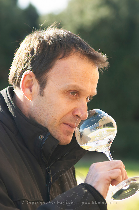 Alain Chabanon Domaine Alain Chabanon, previously Font Caude, in the Lagamas village. Montpeyroux. Languedoc. Owner winemaker. Tasting wine. France. Europe. Wine glass.