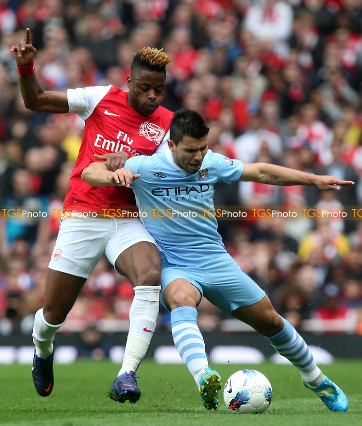 Alexandre Song of Arsenal and Sergio Aguero of Manchester City -  Arsenal - Manchester City at the Emirates Stadium - 08/04/12 - MANDATORY CREDIT: Dave Simpson/TGSPHOTO - Self billing applies where appropriate - 0845 094 6026 - contact@tgsphoto.co.uk - NO UNPAID USE.