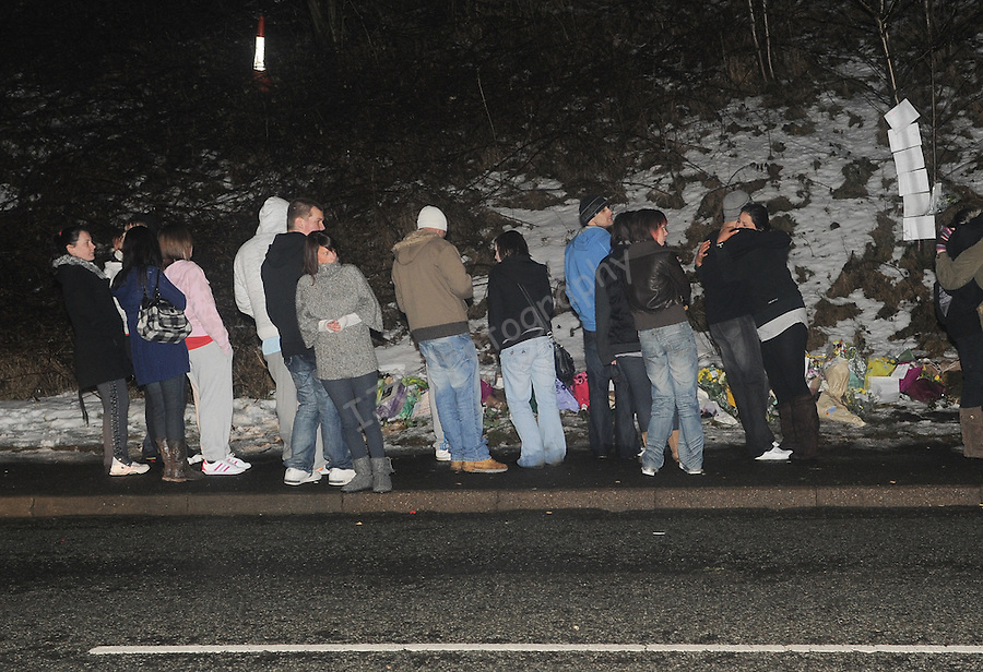 Family and Friends of Anthony Farley (age 19) visit the site to pay their respects, where Anthony was tragically killed while tobogganing with a friend on Sunday 21st February 2010. ..Date: 24th February 2010, Tredegar, Chartist Way.© Ian Cook IJC Photography, 07599826381,  iancook@ijcphotography.co.uk, www.ijcphotography.co.uk