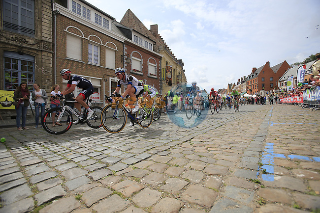 The peleton including John Degenkolb (GER) Team Giant-Shimano pass through the ancient town of Cassel during Stage 4 of the 2014 Tour de France running 163.5km from Le Touquet to Lille. 8th July 2014.<br /> Picture: Eoin Clarke www.newsfile.ie