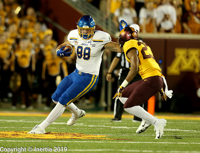 MINNEAPOLIS, MN - AUGUST 29: Blake Kunz #88 from South Dakota State University looks to make a move against Jordan Howden #23 from the University of Minnesota during their game Thursday night at TCF Bank Stadium in Minneapolis, MN. (Photo by Dave Eggen/Inertia)