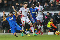 Andy Barcham of AFC Wimbledon falls to the floor during the Sky Bet League 1 match between MK Dons and AFC Wimbledon at stadium:mk, Milton Keynes, England on 13 January 2018. Photo by David Horn.
