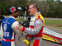Mar 16, 2014; Gainesville, FL, USA; NHRA top fuel driver Doug Kalitta (right) is congratulated by Antron Brown after winning the Gatornationals at Gainesville Raceway Mandatory Credit: Mark J. Rebilas-USA TODAY Sports
