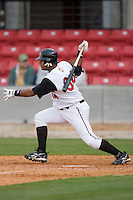 Juan Francisco #34 of the Carolina Mudcats follows through on his swing versus the Jacksonville Suns at Five County Stadium May 18, 2009 in Zebulon, North Carolina. (Photo by Brian Westerholt / Four Seam Images)