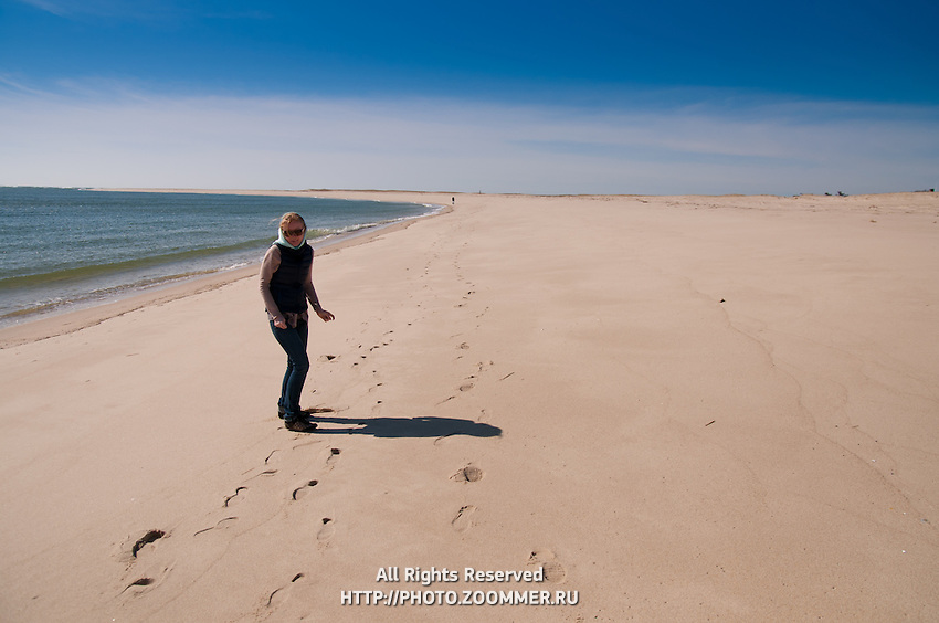 Girl walking along the beach in Chatham In low season, Cape Cod