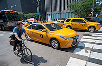Taxis share the road with bikes and other traffic in New York on Thursday, September 3, 2015. Because of the rise in Uber and other apps taxi medallions have decreased in worth to about $900,000 with loan delinquencies on the rise. The Melrose Credit Union has $168 million in delinquencies as of May 2015 while in January 2014 it had only $32,000. In the next six months Melrose has $212 million in maturing loans which many owners will be unable to pay.   (© Richard B. Levine)