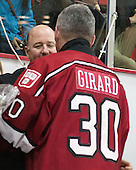 Raphael Girard's (Harvard - 30) father with Ted Donato (Harvard - Head Coach) - The Harvard University Crimson honored their seniors following their final home game of the regular season on Saturday, February 22, 2014 at the Bright-Landry Hockey Center in Cambridge, Massachusetts.