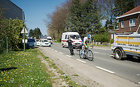 Michael Matthews (AUS/Orica-GreenEDGE) is already between the last vehicles in the convoy after a mechanical as he is pushed on his way again<br /> <br /> 55th Brabantse Pijl 2015
