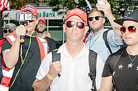 Men wearing red Trump MAGA hats take part in the Straight Pride Parade in Boston, Massachusetts, on Sat., August 31, 2019. The parade was organized in reaction to LGBTQ Pride month activities by an organization called Super Happy Fun America.
