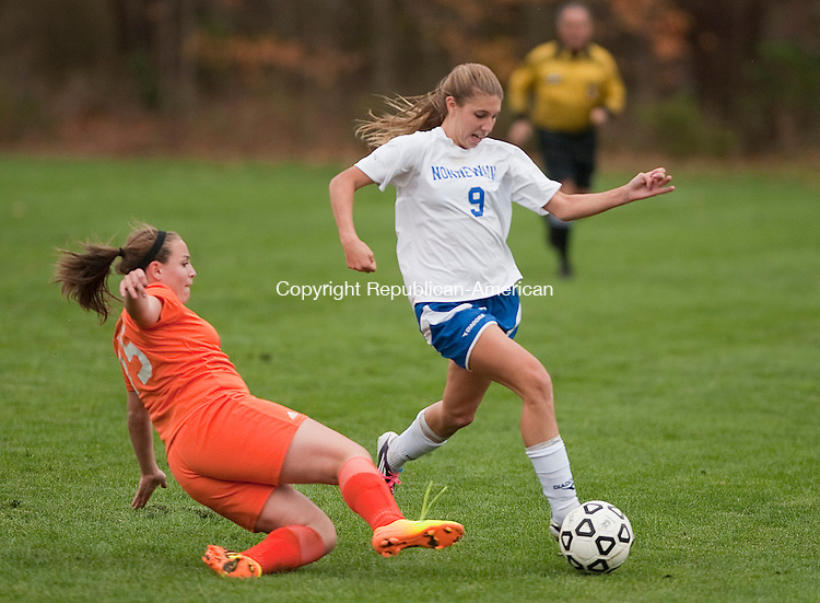 WOODBURY- 102213JS10- Nonnewaug's Hailey Wheeler (9) tries to get around a sliding tackle by Terryville's Julia Quinn (15) during their game Tuesday at Nonnewaug High School in Woodbury.<br /> Jim Shannon Republican-American
