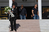 Pictured: A mourner carries flowers after the service at Agios Nektarios church in Voula, Athens Greece. Sunday 04 November 2018<br /> Re: The funeral of Greek-Australian John Macris, who was shot dead outside his house, to be held at the Agios Nektarios Church in the Voula suburb of Athens, Greece.