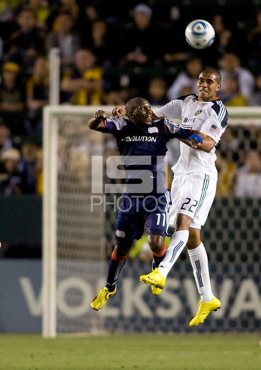 LA Galaxy defender Leonardo battles New England Revolution forward Kheli Dube. The LA Galaxy defeated the New England Revolution 1-0 at Home Depot Center stadium in Carson, California on Saturday evening March 27, 2010.  .