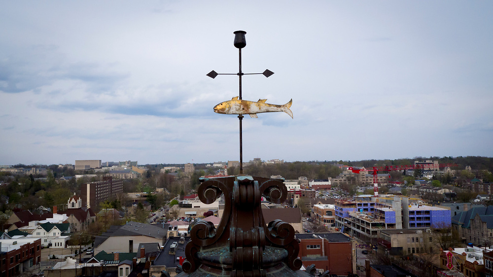 A fish-shaped cooper weathervane adorns the top of the historic Monroe County Courthouse in downtown Bloomington, Indiana on Wednesday, April 25, 2018. Austin Seward, a local blacksmith, is credited with the creation of the fish in the 1820s. (Photo by James Brosher)