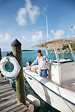 EXUMA, Bahamas. Yves, the Fowl Cay Resort manager getting the boat ready for an excursion.