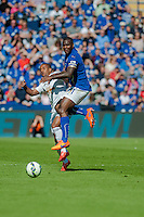 LEICESTER, ENGLAND - APRIL 18: Wayne Routledge of Swansea City  clashes with Wes Morgan of Leicester City during the Premier League match between Leicester City and Swansea City at The King Power Stadium on April 18, 2015 in Leicester, England.  (Photo by Athena Pictures/Getty Images)