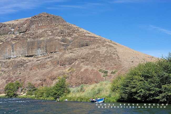 A drift boat and fly fisherman on the Deschutes River.