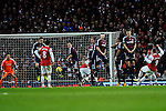 Lukas Podolski of Arsenal scores against Stoke city during the  English Premier League soccer match between Arsenal and Stoke City in London,UK,02 February  2012.THOMAS CAMPEAN/Pixel8000 Ltd...