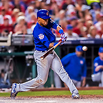 6 October 2017: Chicago Cubs shortstop Addison Russell singles in the 7th inning of the first game of the NLDS against the Washington Nationals at Nationals Park in Washington, DC. The Cubs shut out the Nationals 3-0 to take a 1-0 lead in their best of five Postseason series. Mandatory Credit: Ed Wolfstein Photo *** RAW (NEF) Image File Available ***