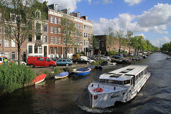 Boats on a canal in Amsterdam, Holland, Netherlands.