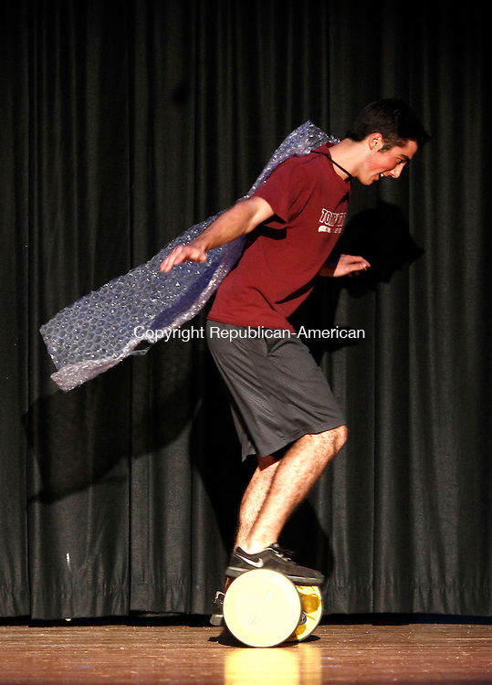Torrington, CT- 17 October 2013-101713CM05-  Torrington senior, Nick LaMothe tries to maintain his balance during a Mr. Raider Contest, a beauty pageant involving students from the high school in Torrington Thursday night.  10 students, from sophomore to seniors participated in the event.  The money raised will go towards the charity of the winners' choice. The event is part of the school's homecoming weekend.    Christopher Massa Republican-American