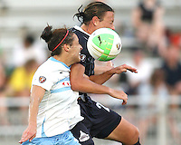 Abby Wambach #20 of the Washington Freedom clashes with Kate Markgraf #15 of the Chicago Red Stars during a WPS match at the Maryland Soccerplex, in Boyds Maryland on June 12 2010. The game ended in a 2-2 tie.