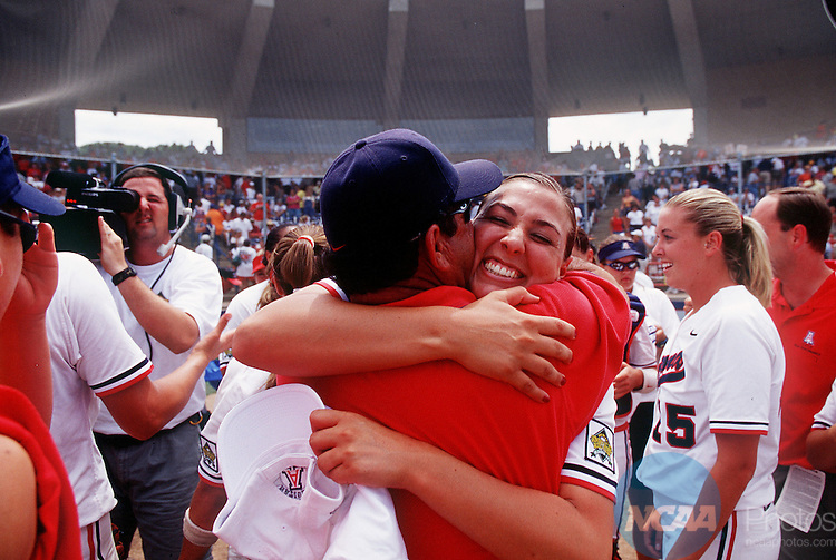 28 MAY 2001:  Teresa Demeter of the University of Arizona (facing camera) celebrates their victory over UCLA during the Women's Division 1 College World Series Softball Championship held at ASA Hall of Fame Stadium in Oklahoma City, OK.  Arizona defeated UCLA 1-0 for the national title.  Chris Landsberger/NCAA Photos