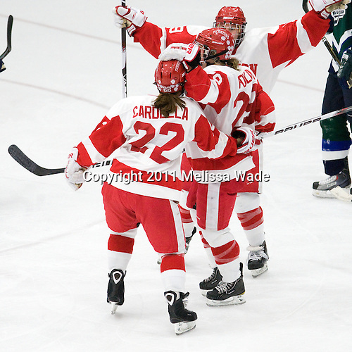 Jill Cardella (BU - 22), Marie-Philip Poulin (BU - 29), Jenelle Kohanchuk (BU - 19) - The Boston University Terriers defeated the visiting Mercyhurst College Lakers 4-2 in their NCAA Quarterfinal matchup on Saturday, March 12, 2011, at Walter Brown Arena in Boston, Massachusetts.