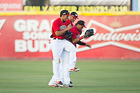 (L-R) Luke Tendler (18), Jairo Beras (5) and Eduard Pinto (2) celebrate their win over the Savannah Sand Gnats at L.P. Frans Stadium on June 14, 2015 in Hickory, North Carolina.  The Crawdads defeated the Sand Gnats 8-1.  (Brian Westerholt/Four Seam Images)
