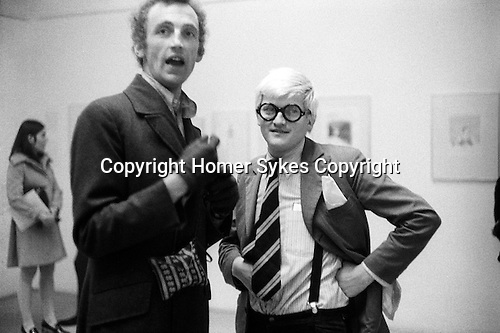"Patrick Procktor and David Hockney. Hockney opening night show  ""Recent Etchings"" at the Kasmin Gallery Bond Street London. 1969."