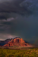 799800171v a summer lightning storm and faint rainbow near the back of west temple south of zion national park as seen from smithsonian national scenic byway near hurricane utah united states