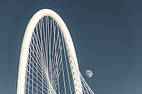 This is a cityscape image we capture of the moon right next to the arch of the Margaret Hunt Hill Bridge. This cable stayed bridge is unique to Dallas and we though it worked very well in this cyan instead of black and white. It is also alvailable in BW just contact us.