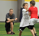 SIOUX FALLS, SD - JULY 2:  Kurtiss Riggs, left, watches players battle for the ball at the Riggs Football Academy Tuesday night at the Sanford Fieldhouse. (Photo by Dave Eggen/Inertia)