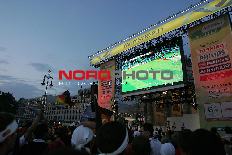 FIFA WM 2006 - Feature Fanmeile Berlin<br /> Play #63 (08-Jul) - Germany vs Portugal.<br /> Supporters from Germany watch the match of Germany against Portugal at Brandenburger Tor in Berlin after the match of the World Cup in Stuttgart.<br /> Foto &copy; nordphoto