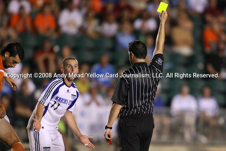 01 July 2008: Referee Niko Bratsis (r) shows a yellow card to Kansas City's Kurt Morsink in the 104th minute. Major League Soccer's Kansas City Wizards defeated The United Soccer Leagues Division 1 Carolina Railhawks 4-2 after overtime at WakeMed Stadium in Cary, NC in a third round game in the 2008 Lamar Hunt U.S. Open Cup.