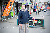 A Franciscan priest distributes free rosaries in the the Hub, in the Melrose section of the New York borough of the Bronx on Sunday, February 5, 2017. The Hub Central Business District gets it's name from the convergence of four roads, East 149th Street, Willis, Melrose and Third Avenues and is the oldest major shopping district in the borough.  (© Richard B. Levine)
