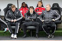 Pictured L-R: Swansea bench Morten Wieghorst, Michael Laudrup and Alan Curtis. Saturday 30 March 2013<br /> Re: Barclay's Premier League, Swansea City FC v Tottenham Hotspur at the Liberty Stadium, south Wales.
