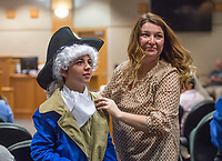NWA Democrat-Gazette/BEN GOFF @NWABENGOFF<br /> Adrianne Kerr, 5th grade teacher, helps Michael Hester with his George Washington costume, Wednesday, March 7, 2018, as 5th grade students from Frank Tillery Elementary in Rogers hold a mock trial at Rogers District Court. The students put on costumes and portrayed historical figures from the American Revolution, putting Benedict Arnold on trial for treason and Capt. Thomas Preston on trial for murder in the Boston Massacre.