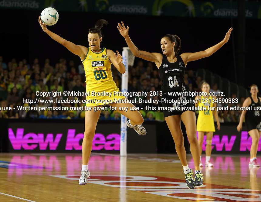 07.10.2013 Silver Fern Maria Tutaia and Australian Diamond Bianca Chatfield in action during the Silver Ferns V Australian Diamonds Netball Series played at the Rod Laver Arena in Melbourne Australia. Mandatory Photo Credit ©Michael Bradley.