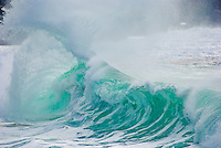 A Beautiful large wave collides with the backwash in the powerful shorebreak at Waimea Bay, on the North Shore of Oahu.