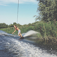 Julian wright wakeskates along the River Bure in the Norfolk Broads in August 2013. Julian and his father are one of the last boats to defy river authority laws, which have crippled the sport in this region in the past 10 years.