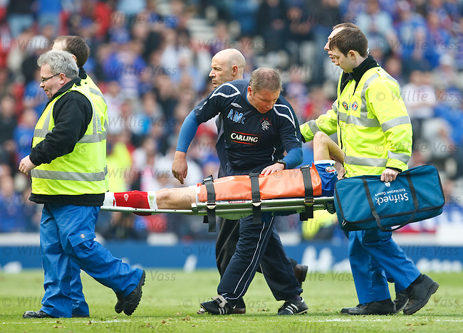 Pedro Mendes istretchered off after colliding with the studs of Will Haining as Ally McCoist checks in on him