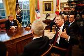 United States Trade Representative Robert Lighthizer confers with Liu He, Vice Premier of the People's Republic of China, as US President Donald J. Trump looks on in the Oval Office of the White House, in Washington, DC, February 22, 2019.  Also pictured at right is US Secretary of the Treasury Steven T. Mnunchin.<br /> Credit: Martin H. Simon / CNP