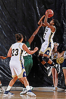11 November 2011:  FIU's Jerica Coley (22) shoots a jump shot over Jacksonville's Jane'l Osborne (25) in the first half as the FIU Golden Panthers defeated the Jacksonville University Dolphins, 63-37, at the U.S. Century Bank Arena in Miami, Florida.